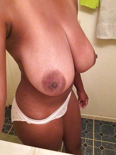 Svart ludern i fria nakna bilder